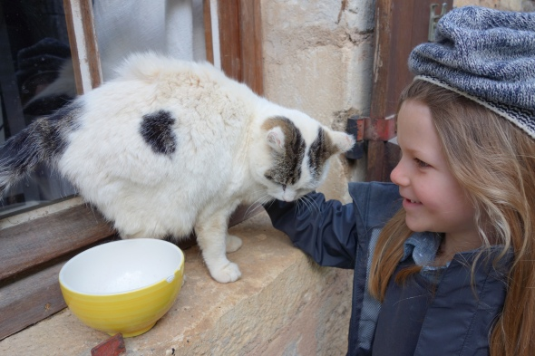 My daughter opts to completely skip the castle in favor of making friends with le chat.