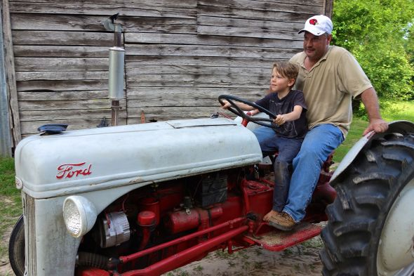 My son on Uncle J's tractor